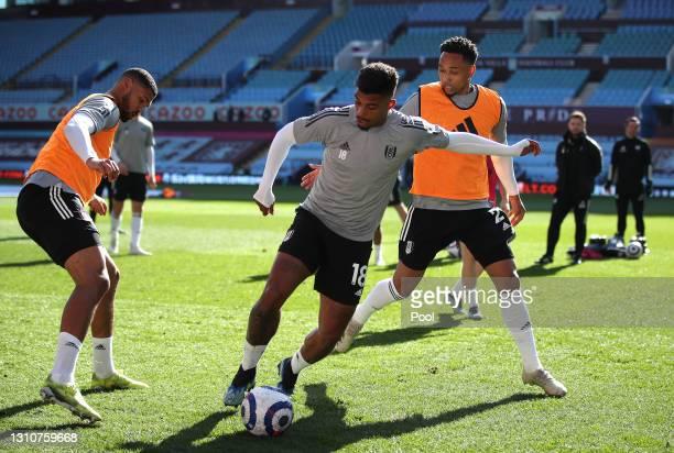 Mario Lemina, Ruben Loftus-Cheek and Kenny Tete of Fulham warm up prior to the Premier League match between Aston Villa and Fulham at Villa Park on...