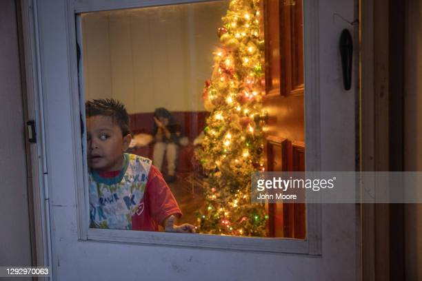 Mario looks from his family's home where 8 out of 10 family members are Covid-19 positive on December 24, 2020 in Stamford, Connecticut. The...