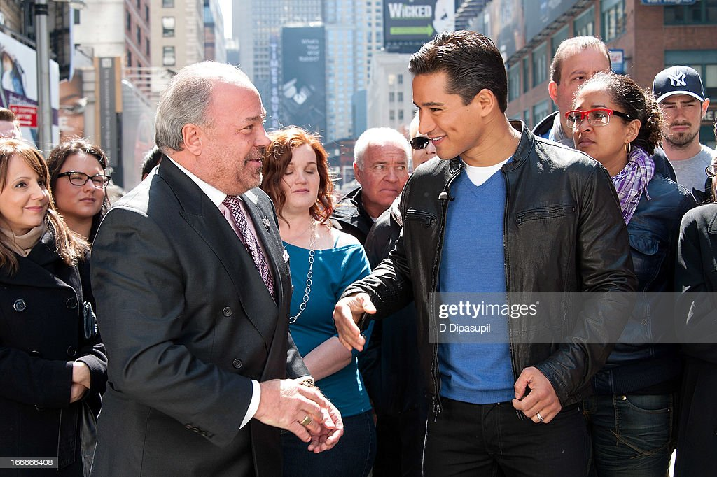 Mario Lopez (R) and Bo Dietl visit 'Extra' in Times Square on April 15, 2013 in New York City.