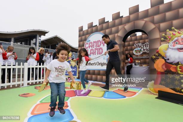 Mario Lopez and children Gia and Dominic navigate lifesized CANDY LAND The Werther's Caramel Edition Game on National Caramel Day at Santa Monica...