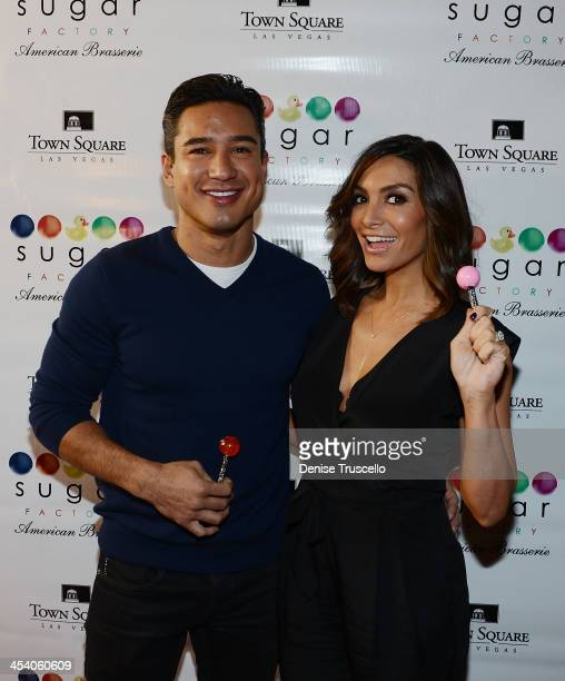 Mario Lopez and Courthey Mazza arrive at the Sugar Factory grand opening at Town Square on December 6 2013 in Las Vegas Nevada