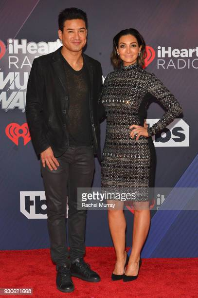 Mario Lopez and Courtney Laine Mazza arrive at the 2018 iHeartRadio Music Awards which broadcasted live on TBS TNT and truTV at The Forum on March 11...