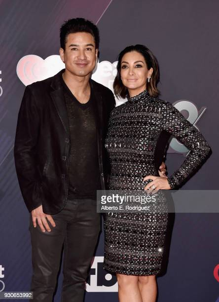 Mario Lopez and Courtney Lopez arrive at the 2018 iHeartRadio Music Awards which broadcasted live on TBS TNT and truTV at The Forum on March 11 2018...