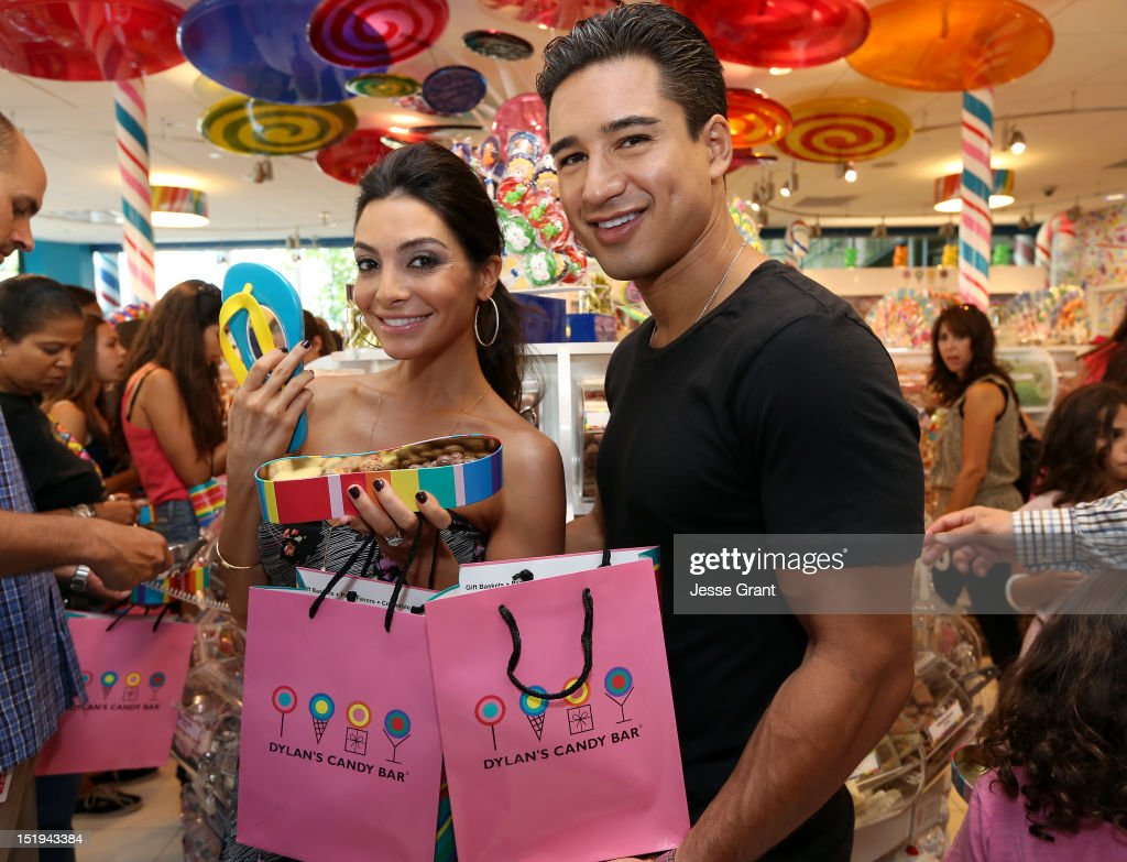 Mario Lopez (R) and Courtney Mazza attend the Dylan's Candy Bar Los Angeles Opening at the Original Farmers Market on September 8, 2012 in Los Angeles, California.