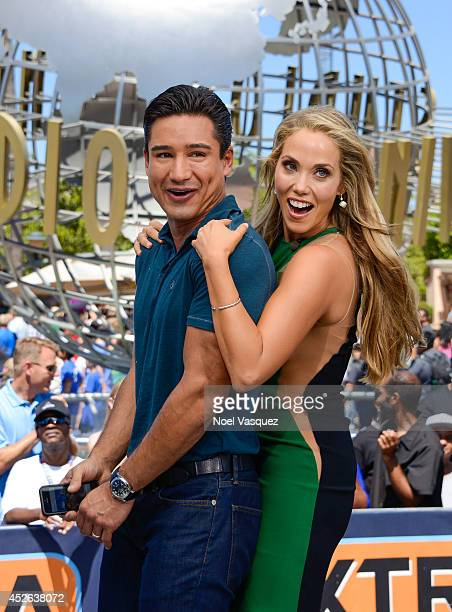 Mario Lopez and Elizabeth Berkely visit 'Extra' at Universal Studios Hollywood on July 24 2014 in Universal City California