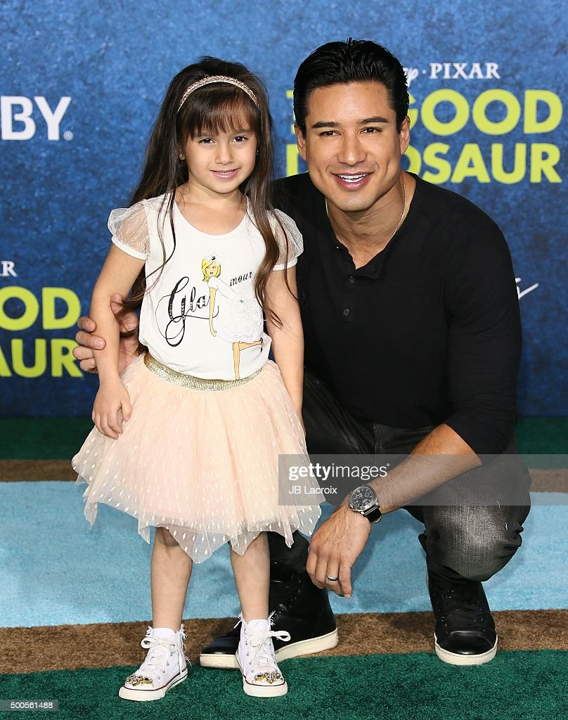 Mario Lopez and Gia Lopez arrive at the premiere of Disney-Pixar's 'The Good Dinosaur' on November 17, 2015 in Hollywood, California.