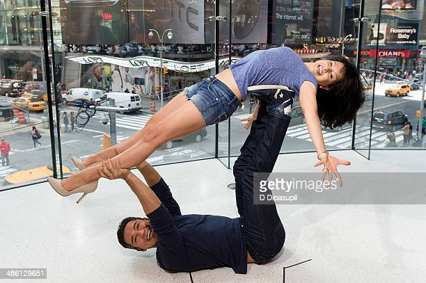 Mario Lopez and Hilaria Baldwin host 'Extra' at their New York studios at H&M in Times Square on April 22, 2014 in New York City.