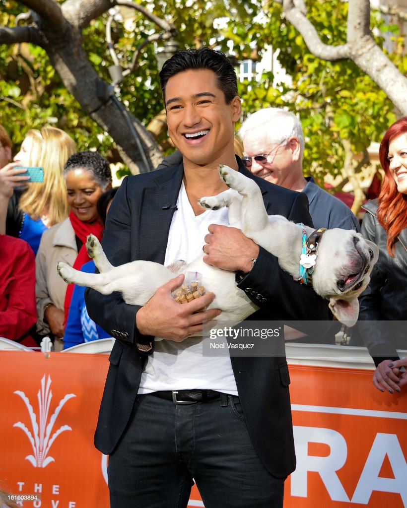 Mario Lopez and his dog Julio Cesar Chavez Lopez visits Extra at The Grove on February 12, 2013 in Los Angeles, California.