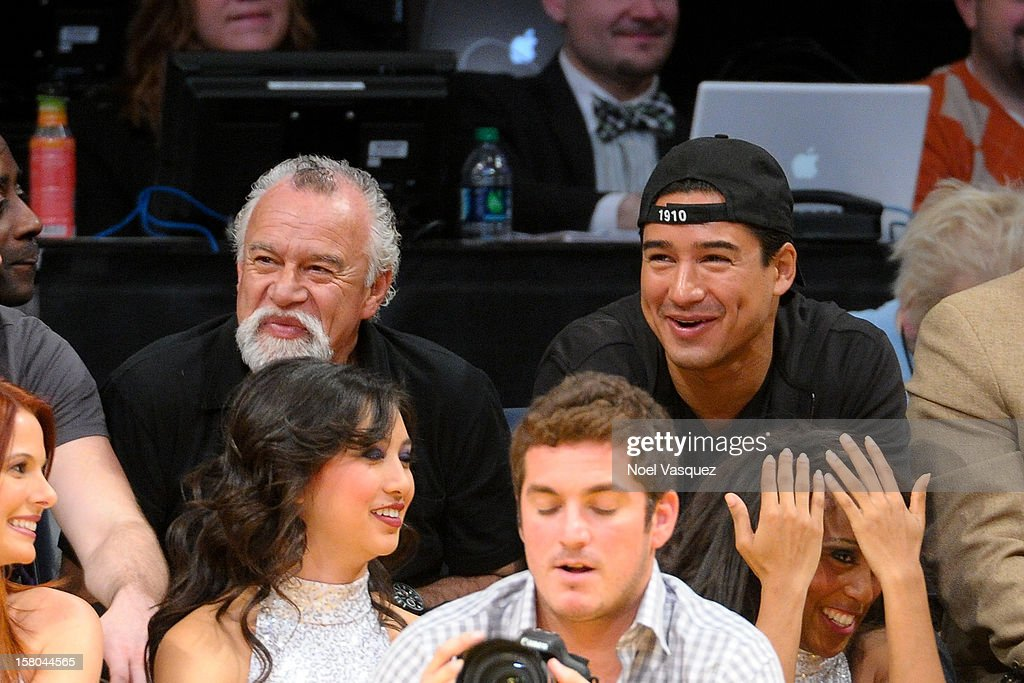 Mario Lopez and his father Mario Michael Lopez attend a basketball game between the Utah Jazz and the Los Angeles Lakers at Staples Center on December 9, 2012 in Los Angeles, California.