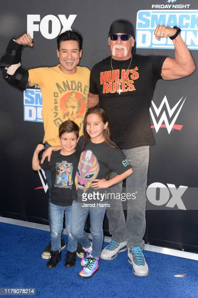 Mario Lopez and Hulk Hogan pose with Dominic and Gia Francesca at the WWE 20th Anniversary Celebration Marking Premiere of WWE Friday Night SmackDown...