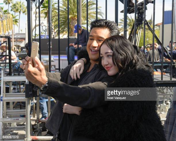 Mario Lopez and Noah Cyrus take a selfie at 'Extra' at Universal Studios Hollywood on February 24 2017 in Universal City California