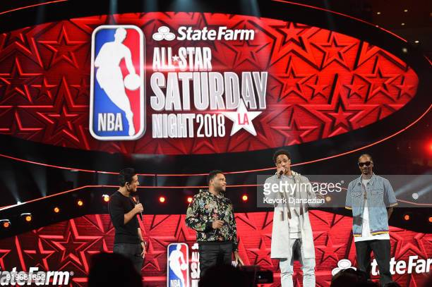 Mario Lopez Anthony Anderson DeMar Derozan and Snoop Dogg speak onstage prior to the 2018 Taco Bell Skills Challenge at Staples Center on February 17...