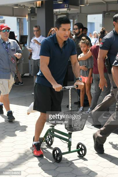 Mario Lopez arrives at 'Extra' at Universal Studios Hollywood on July 16 2018 in Universal City California Lopez returns to set after injuring his...