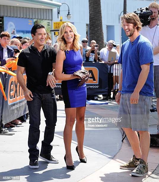 Mario Lopez Charissa Thompson and Clayton Kershaw visit Extra at Universal Studios Hollywood on August 20 2014 in Universal City California