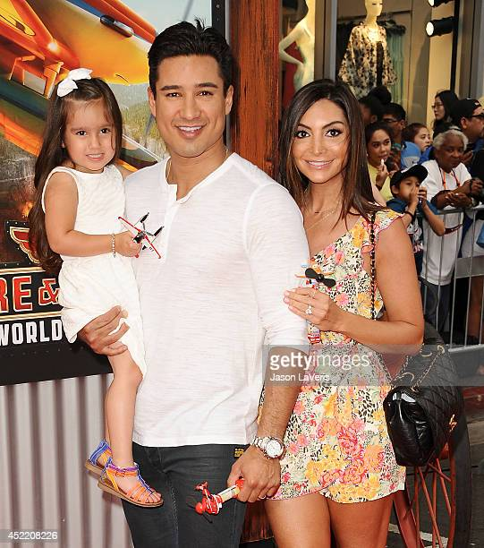 "Mario Lopez, Courtney Mazza and daughter Gia Francesca Lopez attend the premiere of ""Planes: Fire & Rescue"" at the El Capitan Theatre on July 15,..."