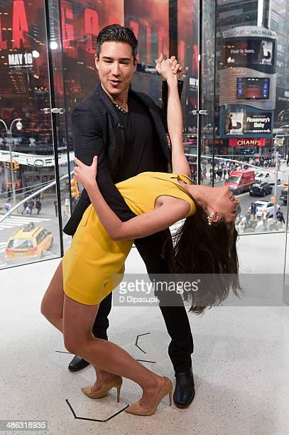 Mario Lopez dances with Abby Hunstman during her visit to 'Extra' at their New York studios at HM in Times Square on April 23 2014 in New York City