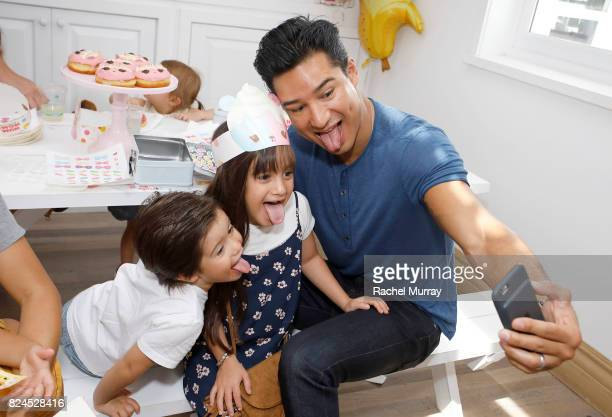 Mario Lopez daughter Gia Francesca Lopez and son Dominic Lopez attend the Num Noms event hosted by Tiffani Thiessen at Au Fudge Los Angeles on July...