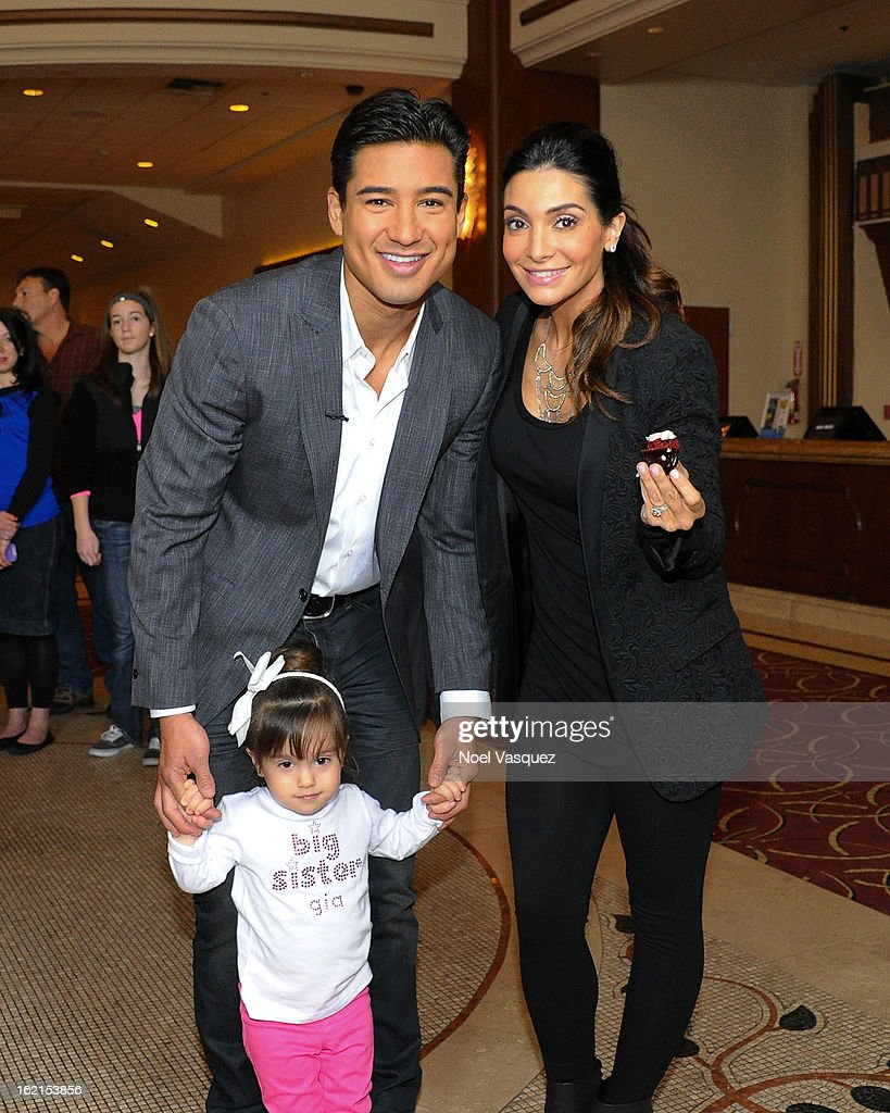 Mario Lopez, Gia Lopez and Courtney Mazza Lopez announce their new baby at Extra at The Grove on February 19, 2013 in Los Angeles, California.