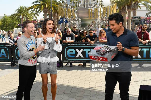 Mario Lopez gives a gift of Diet Coke and MM's to Adam Rippon and Jenna Johnson visit 'Extra' at Universal Studios Hollywood on May 8 2018 in...