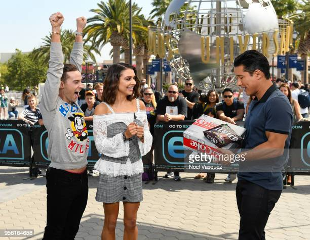 Mario Lopez gives the gift of Diet Cokes and MM's to Adam Rippon and Jenna Johnson visit 'Extra' at Universal Studios Hollywood on May 8 2018 in...