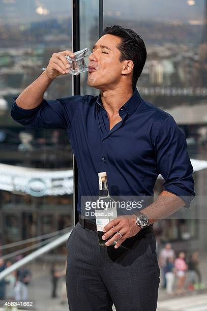"Mario Lopez hosts ""Extra"" at their New York studios at H&M in Times Square on September 29, 2014 in New York City."