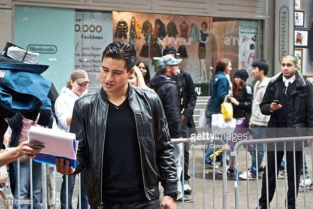 Mario Lopez reviewing notes during a production in Times Square, New York City