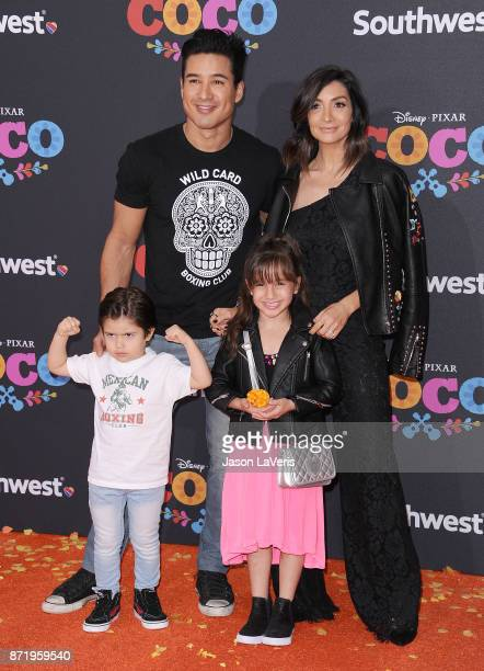 "Mario Lopez, wife Courtney Laine Mazza and children Dominic Lopez and Gia Francesca Lopez attend the premiere of ""Coco"" at El Capitan Theatre on..."
