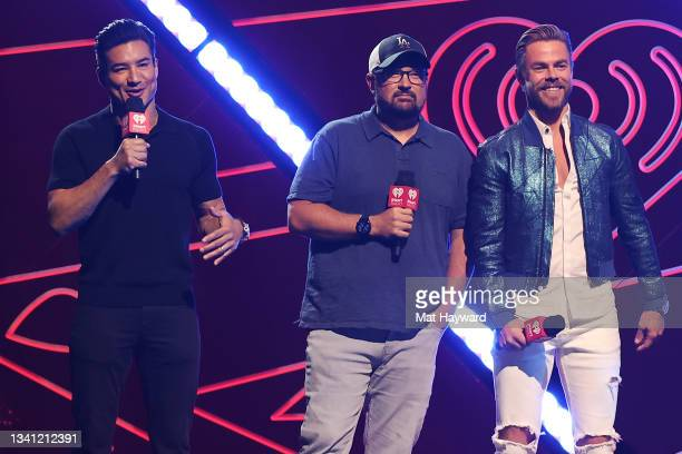 Mario Lopez, Woody, and Derek Hough speak onstage during the 2021 iHeartRadio Music Festival at T-Mobile Arena on September 18, 2021 in Las Vegas,...