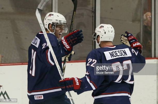 Mario Lucia of the USA Blue Squad celebrates his game winning goal at 19:25 of the third period along with Stefan Noesen against Team Finland at the...