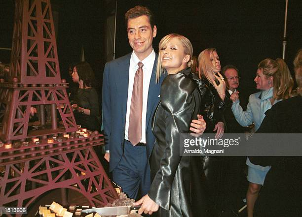 Mario Maccioni helps Paris Hilton cut cake to celebrate birthday backstage after Lloyd Klein's presentation of his fall/winter 2001 collection...