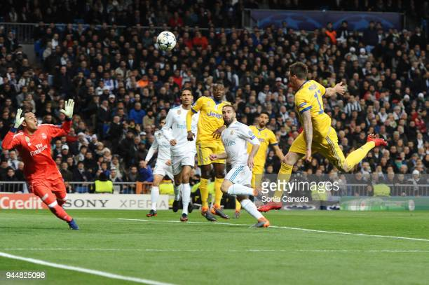 Mario Mandzukic #17 of Juventus scores to make it 10 during the UEFA Champions League Quarter Final Leg Two between Club Real Madrid and Juventus at...