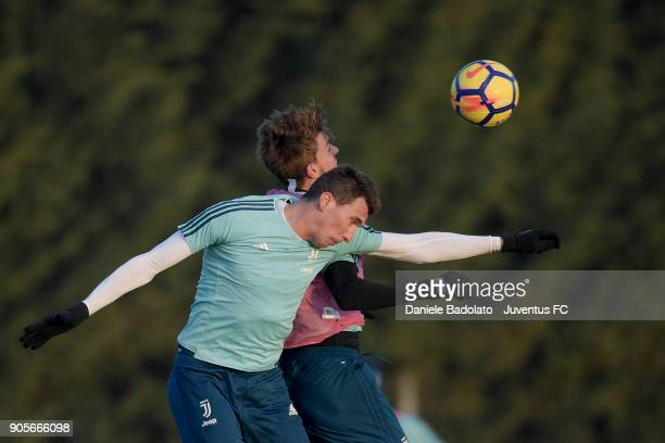 Mario Mandzukic and Daniele Rugani during a Juventus Training Session at Juventus Center Vinovo on January 16 2018 in Vinovo Italy