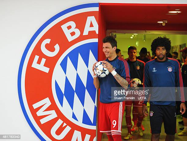 Mario Mandzukic and Dante of Bayern Munich walk out for the warm up prior to the UEFA Champions League Semi Final second leg match between FC Bayern...