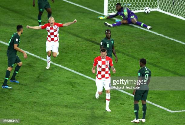 Mario Mandzukic and Domagoj Vida of Croatia celebrate after Oghenekaro Etebo of Nigeria scores an own goal Croatcrosses's first goal during the 2018...