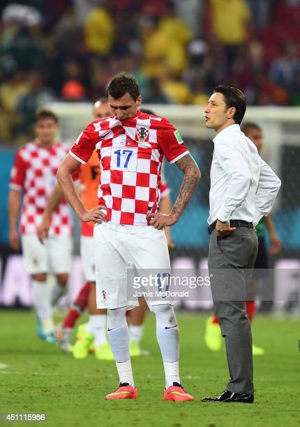 Mario Mandzukic and head coach Niko Kovac of Croatia look dejected after a 31 defeat in the 2014 FIFA World Cup Brazil Group A match between Croatia...