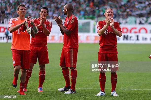 Mario Mandzukic Claudio Pizarro Jerome Boaten gand Bastian Schweinsteigerof Bayern celebrate the 30 victory after the Bundesliga match between...