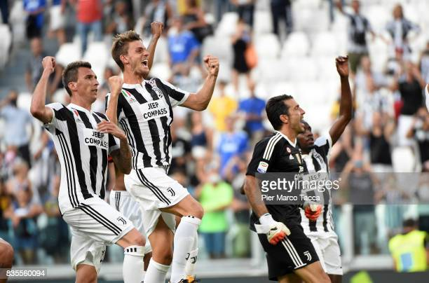 Mario Mandzukic Daniele Rugani and Gianluigi Buffon of Juventus FC celebrate the victory during the Serie A match between Juventus and Cagliari...