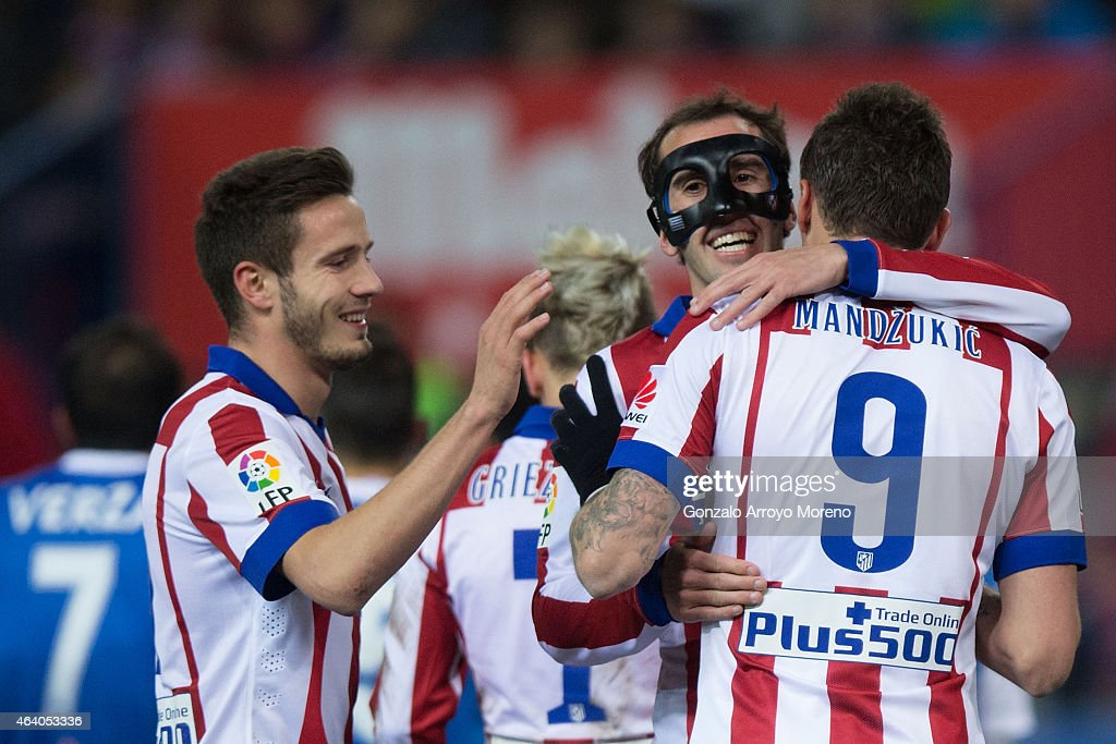 Mario Mandzukic (R) of Atletico de Madrid celebrates the penalty shot given to him with teammates Diego Godin (2ndR) and Saul Niguez (L) during the La Liga match between Club Atletico de Madrid and UD Almeria at Vicente Calderon Stadium on February 21, 2015 in Madrid, Spain.