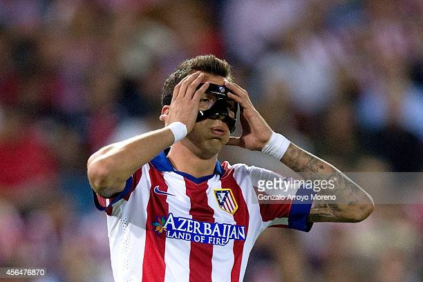 Mario Mandzukic of Atletico de Madrid reacts during the UEFA Champions League group A match between Club Atletico de Madrid and Juventus at Vievnte...