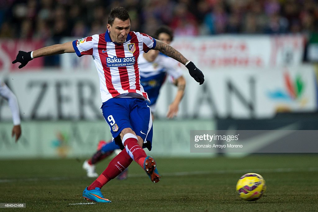 Mario Mandzukic of Atletico de Madrid scores their opening goal from a penlaty shot during the La Liga match between Club Atletico de Madrid and UD Almeria at Vicente Calderon Stadium on February 21, 2015 in Madrid, Spain.