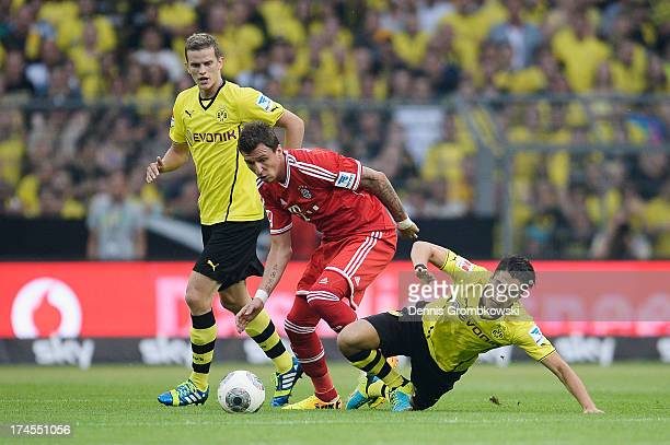 Mario Mandzukic of Bayern Muenchen and Nuri Sahin of Borussia Dortmund battle for the ball during the DFL Supercup match between Borussia Dortmund...