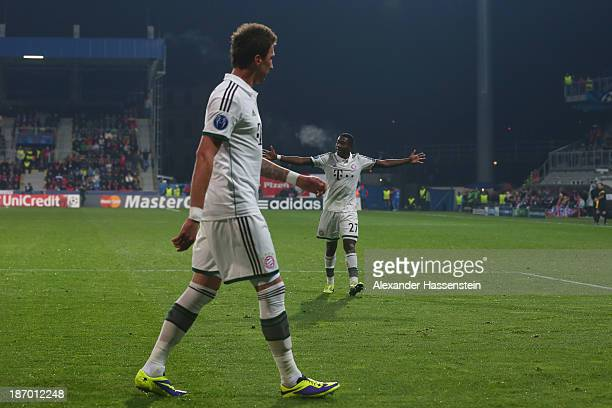 Mario Mandzukic of Bayern Muenchen celebrates scoring the opening goal with his team mate David Alaba during the UEFA Champions League group D match...