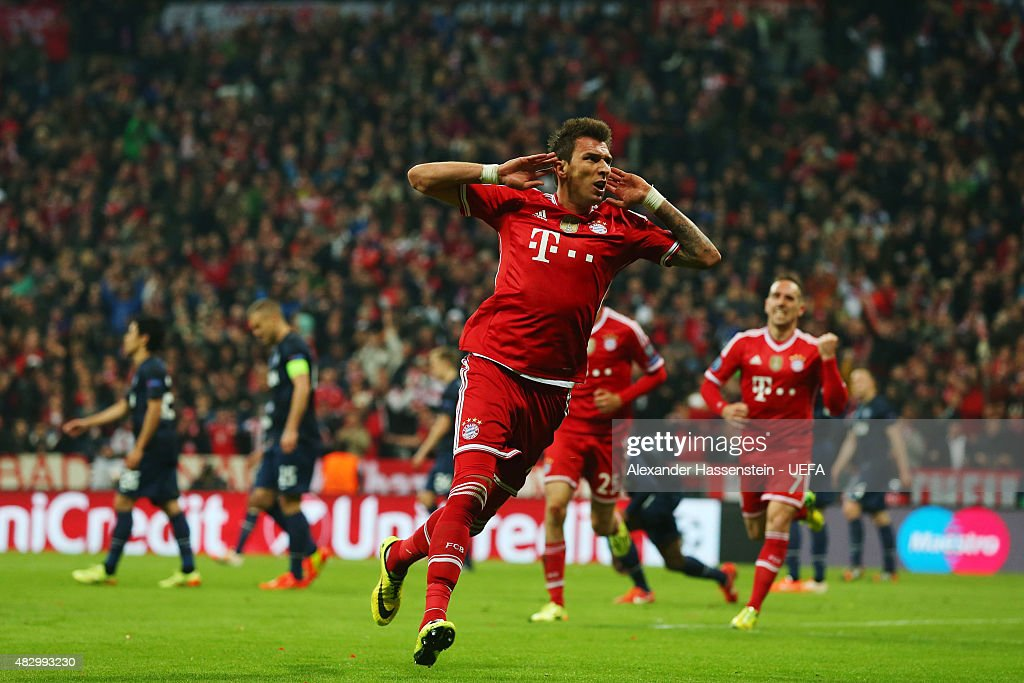 Mario Mandzukic of Bayern Muenchen celebrates scoring their first goal during the UEFA Champions League Quarter Final second leg match between FC Bayern Muenchen and Manchester United at Allianz Arena on April 9, 2014 in Munich, Germany.