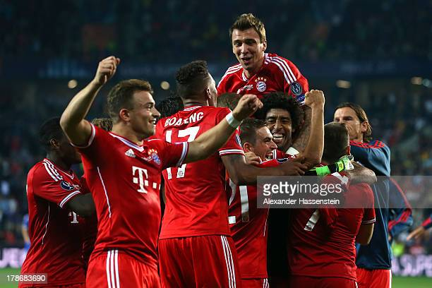 Mario Mandzukic of Bayern Muenchen celebrates victory with his team mate Philipp Lahm and others after the UEFA Super Cup between FC Bayern Muenchen...