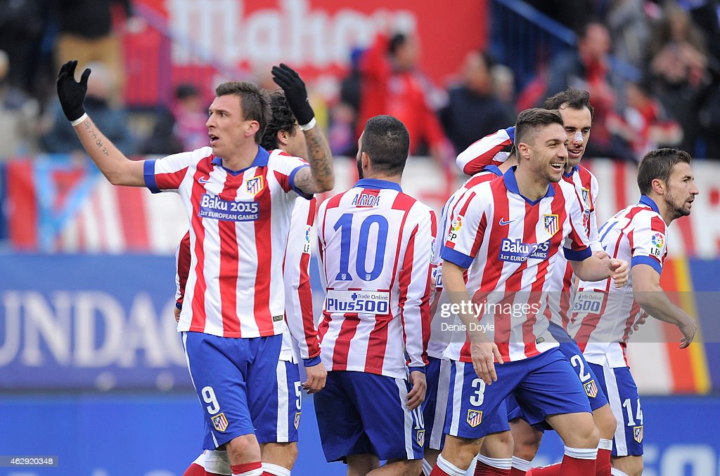 Mario Mandzukic of Club Atletico de Madrid celebrates after scoring his team's 4th goal during the La Liga match between Club Atletico de Madrid and Real Madrid at Vicente Calderon Stadium on February 7, 2015 in Madrid, Spain.