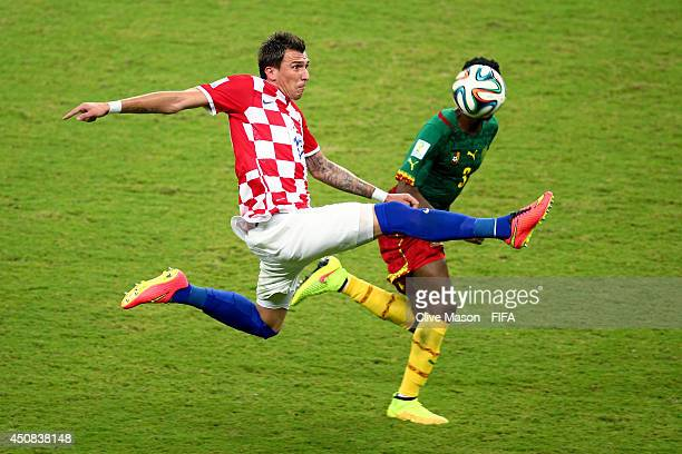 Mario Mandzukic of Croatia and Nicolas N'Koulou of Cameroon compete for the ball during the 2014 FIFA World Cup Brazil Group A match between Cameroon...