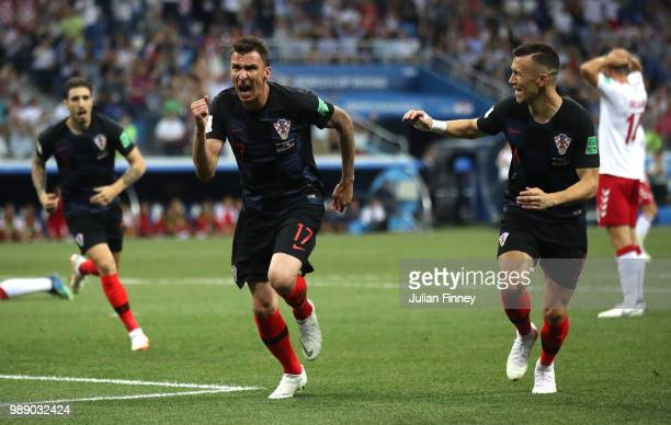 Mario Mandzukic of Croatia celebrates after scoring his team's first goal during the 2018 FIFA World Cup Russia Round of 16 match between Croatia and...