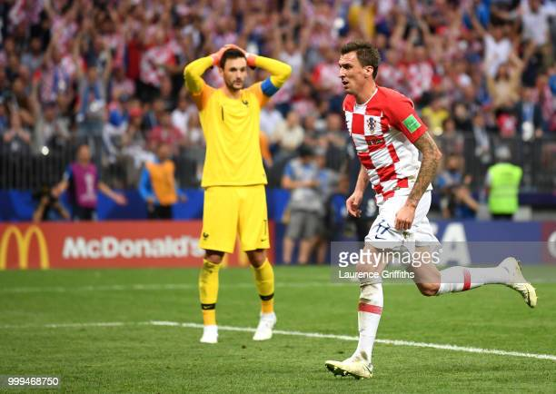 Mario Mandzukic of Croatia celebrates after scoring his team's second goal past Hugo Lloris of France during the 2018 FIFA World Cup Final between...