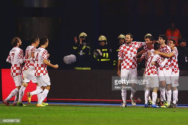 Mario Mandzukic of Croatia celebrates his team's first goal with team mates during the FIFA 2014 World Cup Qualifier playoff second leg match between...