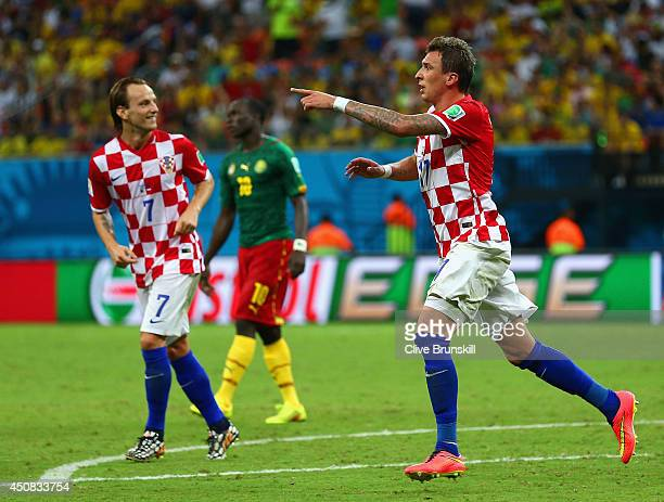 Mario Mandzukic of Croatia celebrates scoring his team's third goal with Ivan Rakitic during the 2014 FIFA World Cup Brazil Group A match between...